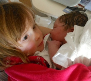 big sister with baby brother