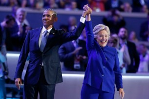 Democratic presidential nominee Hillary Clinton stands with President Barack Obama after his speech at the Democratic National Convention in Philadelphia, Pennsylvania, U.S. July 27, 2016. REUTERS/Lucy Nicholson - RTSK09V